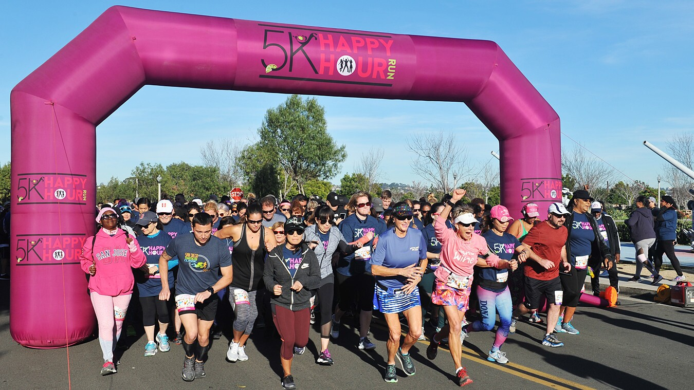 Adults running the 5K Happy Hour Run at Liberty Station enjoyed a beer, wine or margarita at the finish line on Saturday, Jan. 27, 2018.