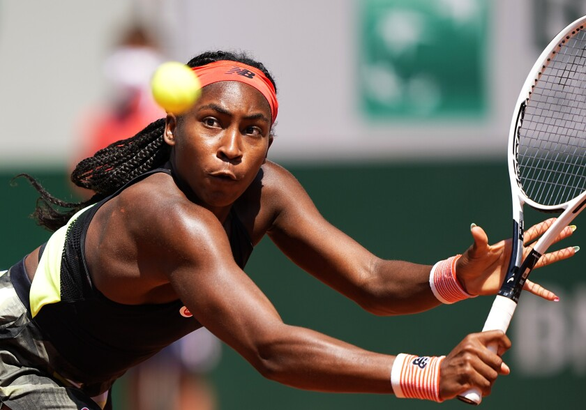 United States's Coco Gauff plays a return to Tunisia's Ons Jabeur during their fourth round match on day 9, of the French Open tennis tournament at Roland Garros in Paris, France, Monday, June 7, 2021. (AP Photo/Michel Euler)