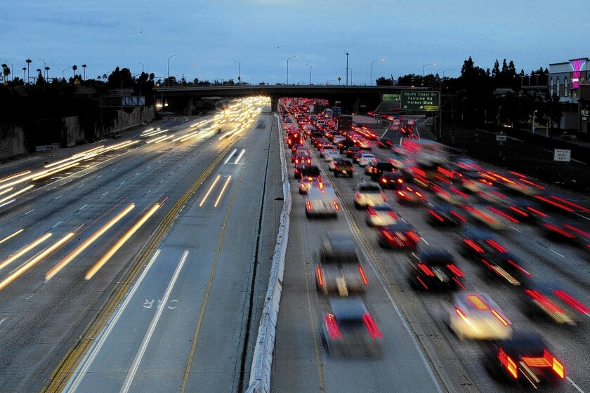 A long camera exposure reveals the blurred lights of motorists traveling on the 405 Freeway through Costa Mesa. Caltrans is planning to build toll lanes on the 405 between the 605 Freeway and Costa Mesa.
