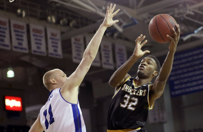 Wichita State forward Markis McDuffie drives to the basket over Drake center Jacob Enevold, left, during the first half of an NCAA college basketball game, Tuesday, Feb. 9, 2016, in Des Moines, Iowa. (AP Photo/Charlie Neibergall)
