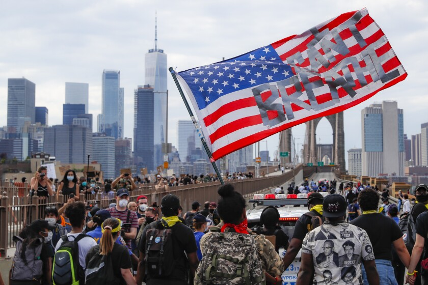 In this June 4, 2020, hundreds march on the Brooklyn Bridge to protest the death of George Floyd.