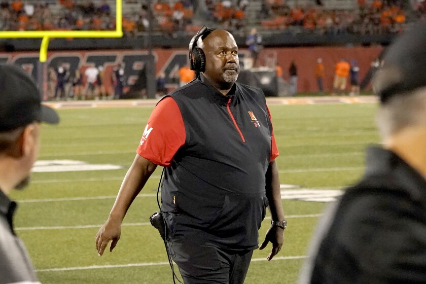 FILE - Maryland head coach Michael Locksley looks up to the scoreboard during the second half of an NCAA college football game against Illinois in Champaign, Ill., in this Friday, Sept. 17, 2021, file photo. Maryland has made it to the end of September unbeaten. Now, over the next two weeks, the Terrapins will find out how far they've come in coach Locksley's third season. On Friday, they host No. 5 Iowa. Then the following week, a trip to Ohio State looms. (AP Photo/Charles Rex Arbogast, File)