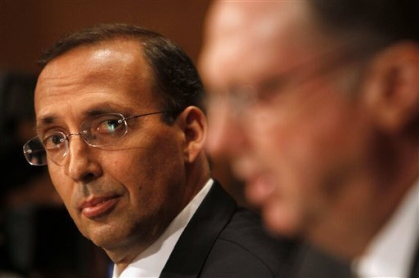 Former AIG CEO Joseph Cassano listens at left, as AIG chief risk officer Robert Lewis testifies on Capitol Hill in Washington, Wednesday,June 30, 2010, before the Financial Crisis Inquiry Commission. (AP Photo/Jacquelyn Martin)