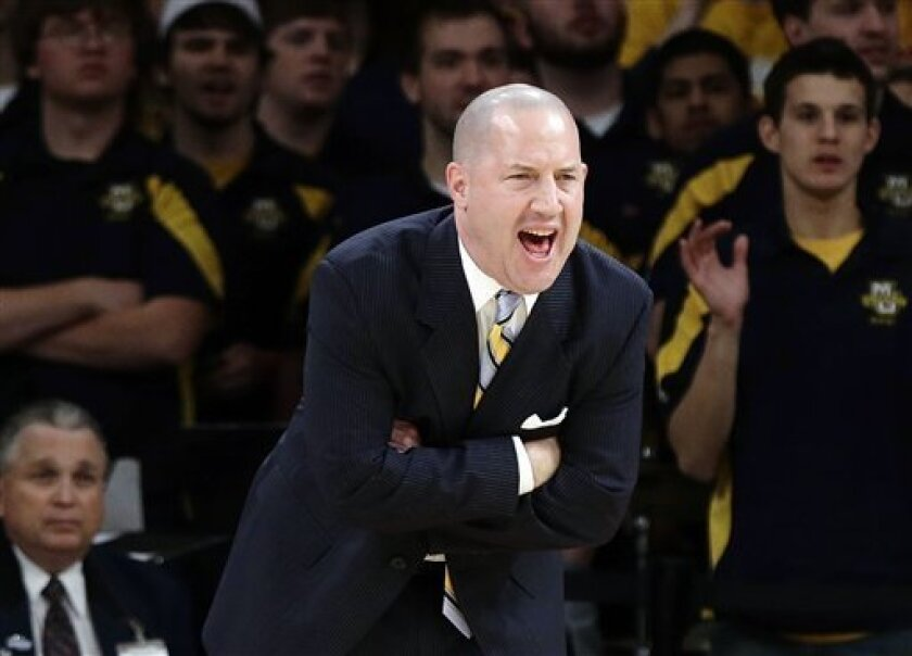 Marquette head coach Buzz Williams calls out to his team during the first half of an NCAA college basketball game against Notre Dame at the Big East Conference tournament, Thursday, March 14, 2013, in New York. (AP Photo/Frank Franklin II)