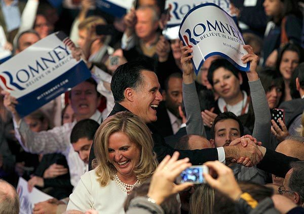 Former Massachusetts Gov. Mitt Romney and his wife, Ann, greet supporters at a victory party at Southern New Hampshire University in Manchester, N.H.