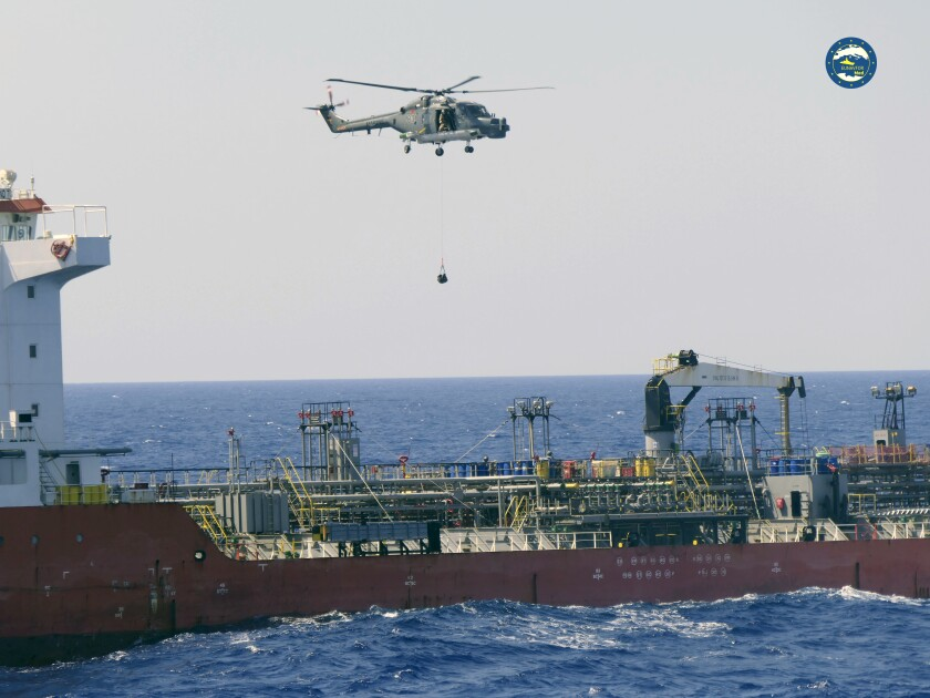A boarding team board the Merchant Vessel Royal Diamond 7, in international waters, 150 kilometers north of the Libyan city of Derna, Thursday, Sept. 10, 2020. The European Union maritime force enforcing the U.N. arms embargo on Libya said Thursday it re-directed a tanker headed for Libya after determining it contained jet fuel in possible violation of the embargo. The MV Royal Diamond 7 was en route early Thursday from Sharjah, United Arab Emirates to Benghazi, Libya when members of the EU force Operation Irini boarded the ship. (EUNAVFOR Med Irini/Italian Defense Ministry via AP)