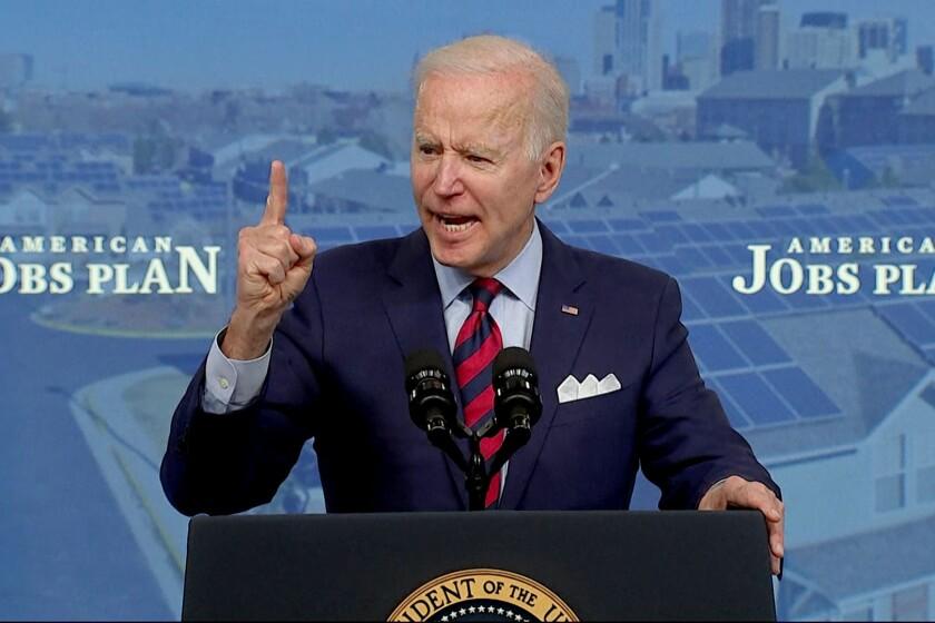 President Biden gestures during a speech on his infrastructure plan.