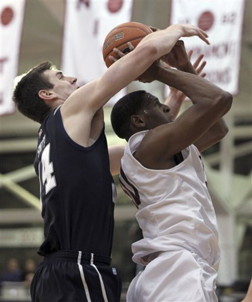 Butler's Kellen Dunham blocks Fordham's Ryan Rhoomes during the first half of an NCAA college basketball game, Saturday, Feb. 16, 2013, in New York. (AP Photo/Mary Altaffer)
