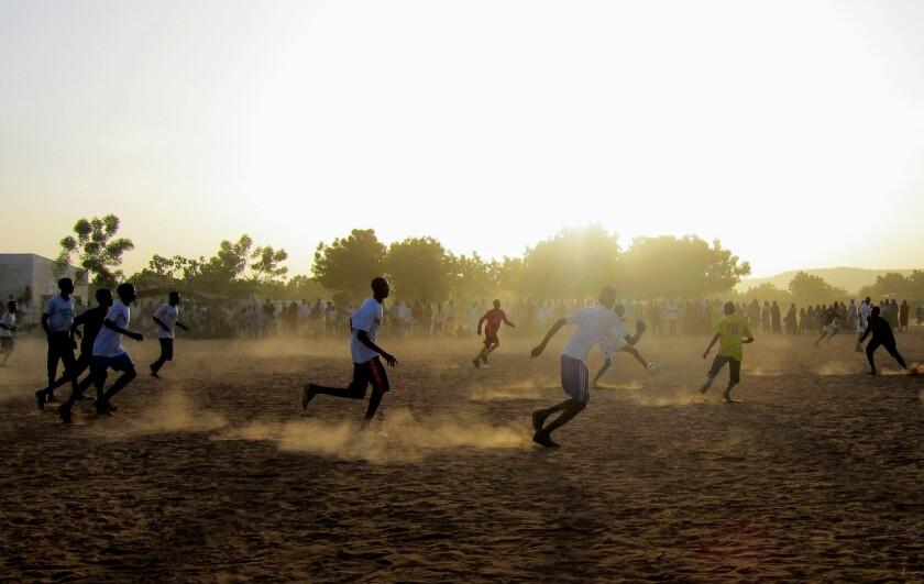 Athletes try out for the first Darfur United men's team roster at refugee camp in 2012