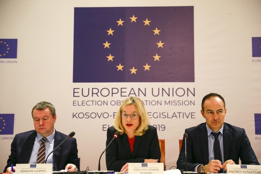 """EU Election Observation Mission headed by Chief Observer Viola von Cramon-Taubadel, center, address media during a press conference in Kosovo capital Pristina on Tuesday, Oct. 8, 2019. More than 100 EU election observers monitored Kosovo's Sunday snap vote when opposition parties won to overcome the former independence fighters who have governed the country since its war 20 years ago, considering the vote as """"well-administered and transparent."""" (AP Photo/Visar Kryeziu)"""