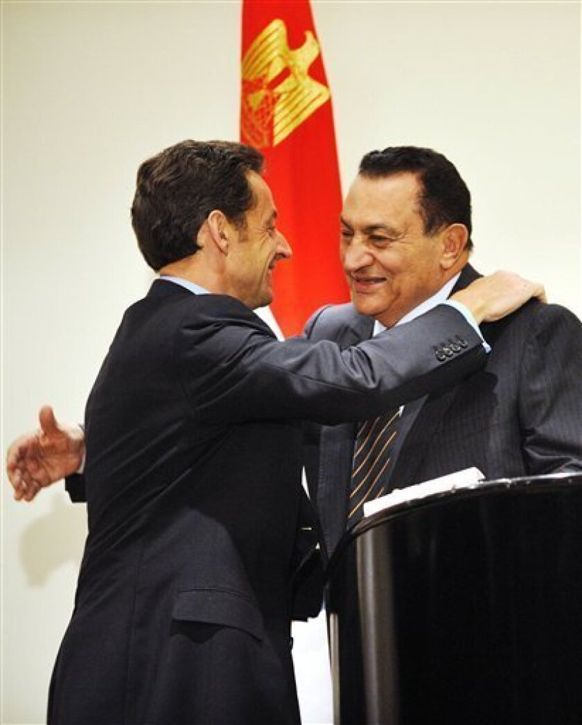 Egyptian President Hosni Mubarak, right, hugs his French counterpart Nicolas Sarkozy at the end of a press conference on Tuesday Jan. 6, 2009 in Sharm el-Sheik, Egypt. Sarkozy said Wednesday Jan. 7, 2009 that Israel and the Palestinian Authority have accepted an Egyptian-French plan for Gaza.   (AP