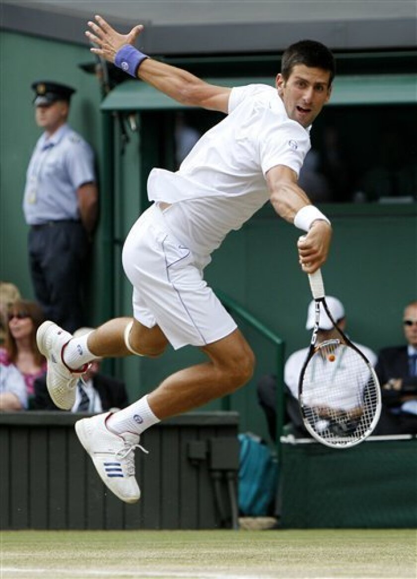 Serbia's Novak Djokovic in action during his semifinal match against France's Jo-Wilfried Tsonga at the All England Lawn Tennis Championships at Wimbledon, Friday, July 1, 2011. (AP Photo/Alastair Grant)