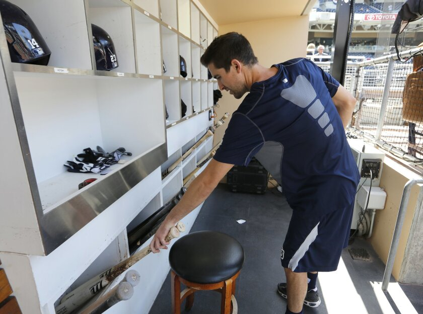 Jonathan Landerholm, a bat boy for the San Diego Padres, gets the team's equipment ready  on opening day for the San Diego Padres Tuesday at Petco Park.