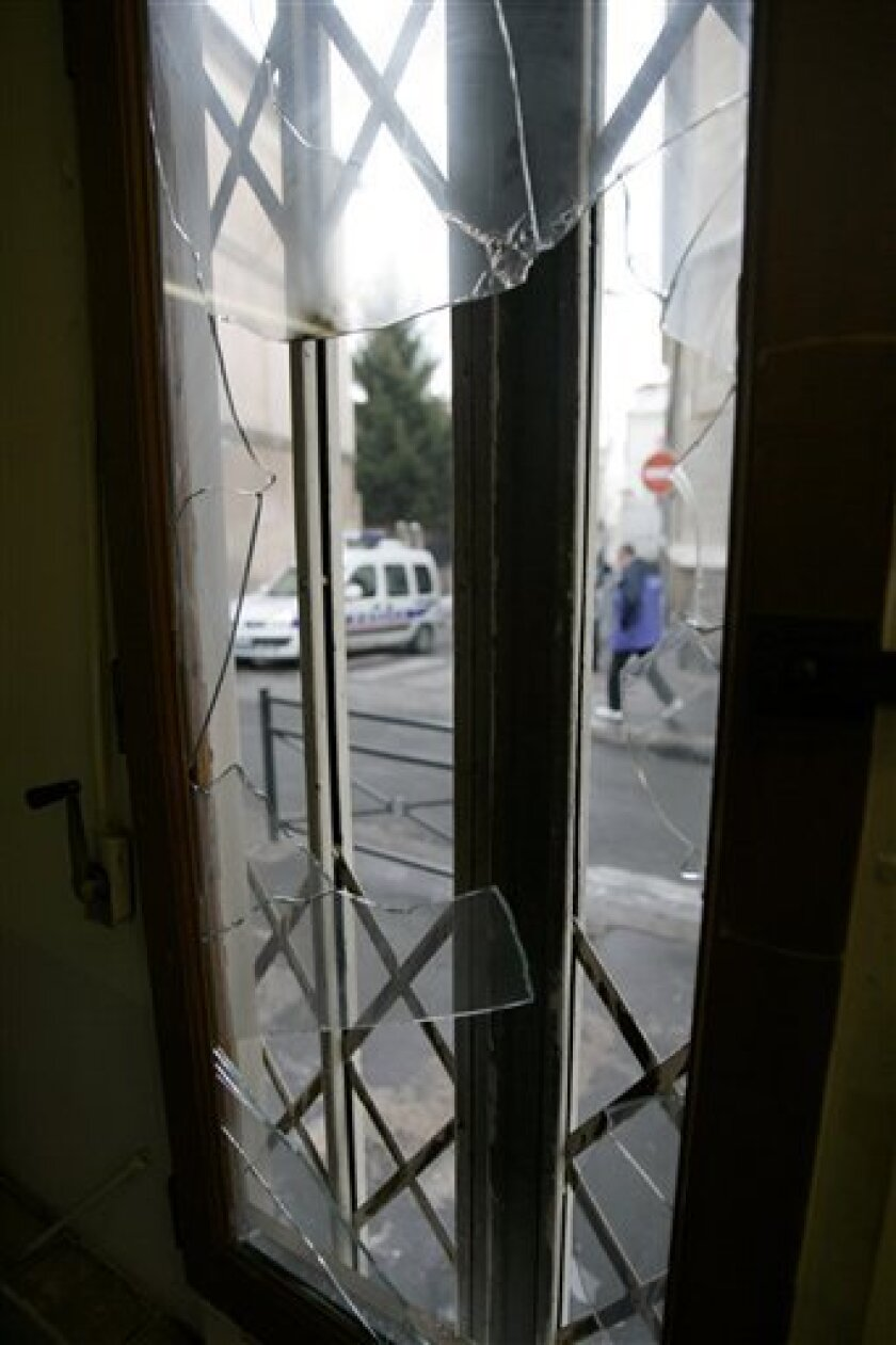 A shattered window of the pizzeria at the Ohr Menahem Community Center in St. Denis, outside Paris, Monday Jan. 12, 2009.  The center, which houses a day care center for autistic children, a restaurant, and a synagogue was attacked with several Molotov cocktails Sunday evening.  It was the latest i