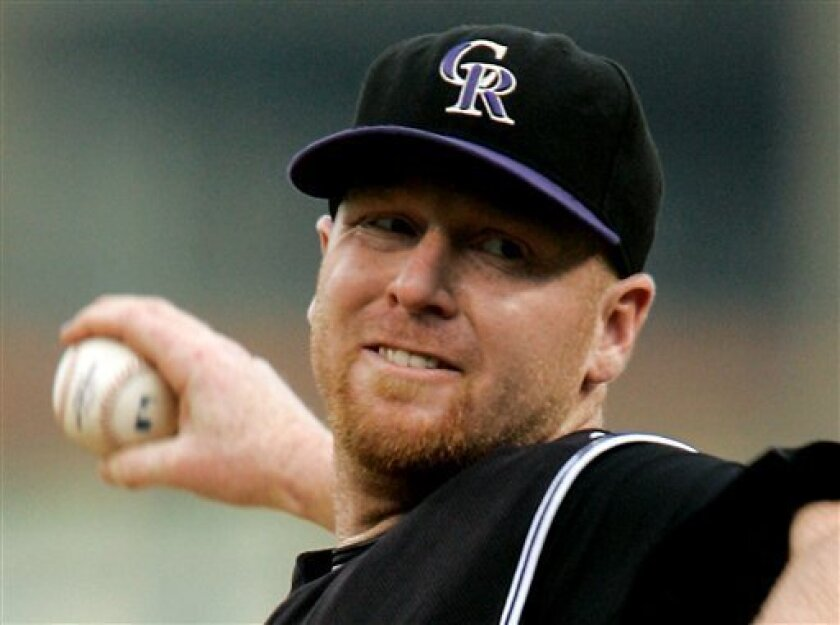 Colorado Rockies pitcher Aaron Cook throws in the first inning of a baseball game against the Pittsburgh Pirates in Pittsburgh Wednesday, July 30, 2008. (AP Photo/Gene J. Puskar)