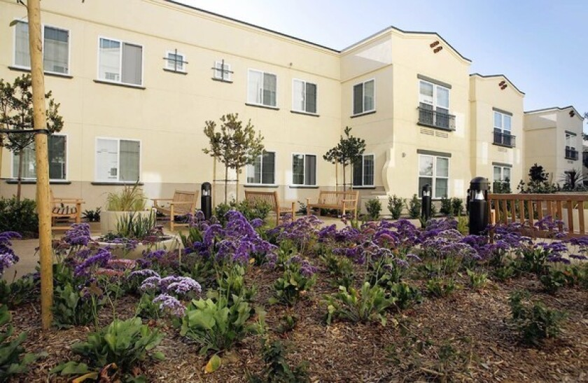 CATCHING RAYS: Casa Dominguez, an environmentally conscious affordable housing development in East Rancho Dominguez, has solar panels on the roof of the multifamily apartment complex.