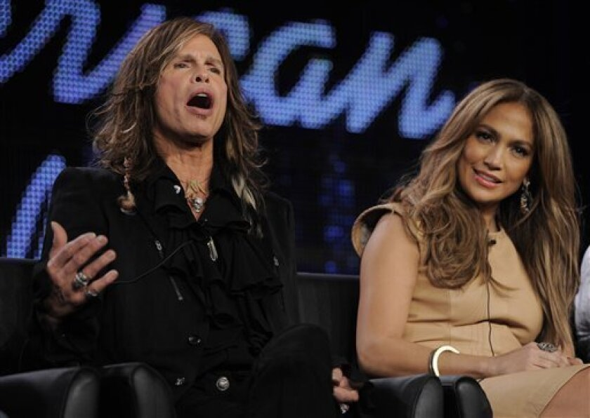 """Steven Tyler, left, and Jennifer Lopez, new judges on """"American Idol,"""" take part in a panel discussion on the show during the FOX Broadcasting Company Television Critics Association winter press tour in Pasadena, Calif., Tuesday, Jan. 11, 2011. (AP Photo/Chris Pizzello)"""