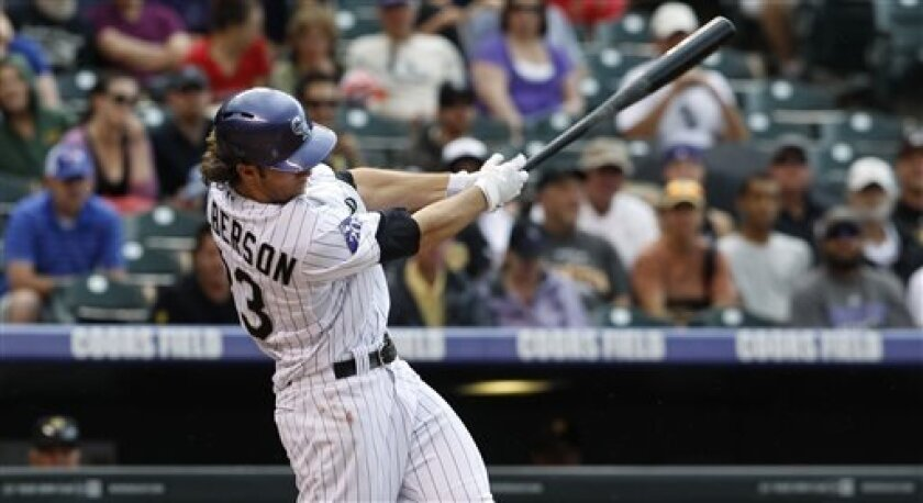 Colorado Rockies' Chrlie Culberson doubles against the Pittsburgh Pirates in the fourth inning a baseball game in Denver on Sunday, Aug. 11, 2013. (AP Photo/David Zalubowski)