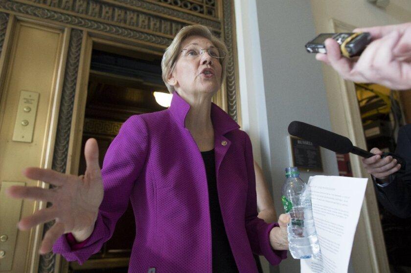 Sen. Elizabeth Warren (D-Mass.) speaks to reporters in the Russell Senate Office Building on Wednesday.
