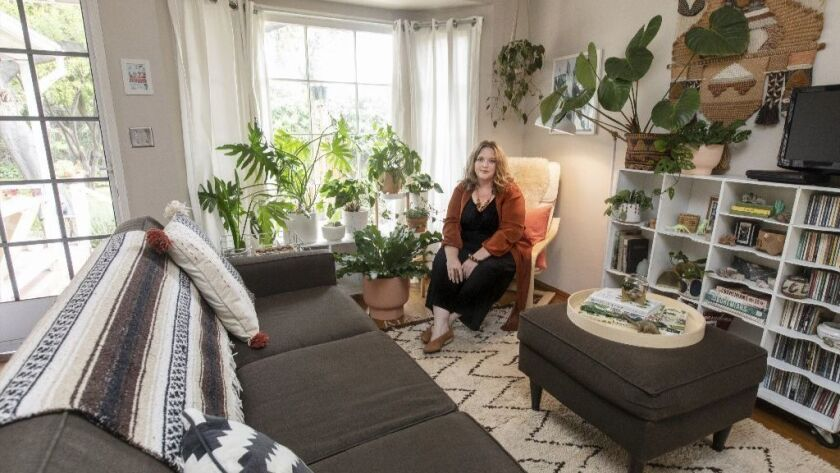 PASADENA, CA - APRIL 03, 2019 - Danae Horst, with her plants in her living room, April 03, 2019. She