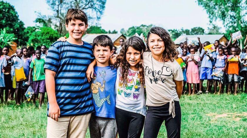 Micah Slentz, Logan Slentz, Anabelle Serratos and Alicia Serratos, visited Uganda last month to deli