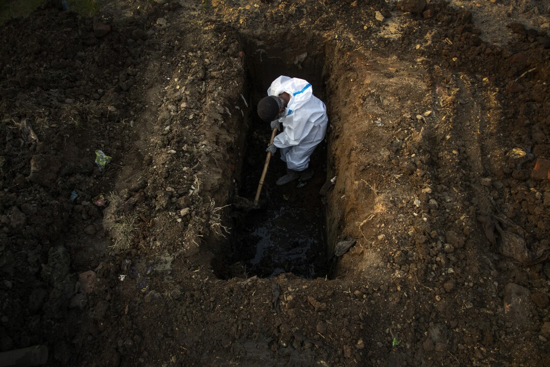 A man digs a grave.
