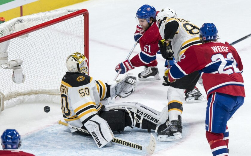 Montreal Canadiens' David Desharnais (51) scores a power play goal past Boston Bruins' goalie Jonas Gustavsson (50) during third period NHL hockey action, in Montreal, on Saturday, Nov. 7, 2015. The Canadiens beat the Bruins 4-2. (Paul Chiasson/The Canadian Press via AP)