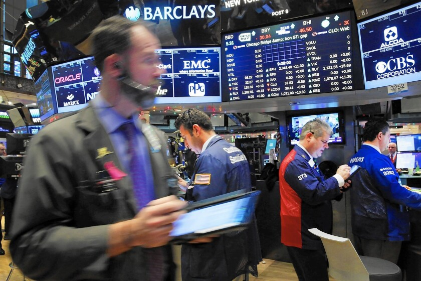 Investors this year have stampeded into a handful of growth companies such as Facebook, Amazon, Netflix and Google parent Alphabet Inc. Much of the rest of the market, meanwhile, has struggled. Above, traders on the floor of the New York Stock Exchange.