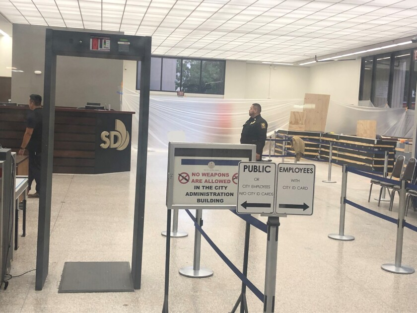 Plastic was taped up Thursday afternoon in the lobby of the San Diego City Administration Building after a piece of ceiling dislodged, sparking asbestos fears.