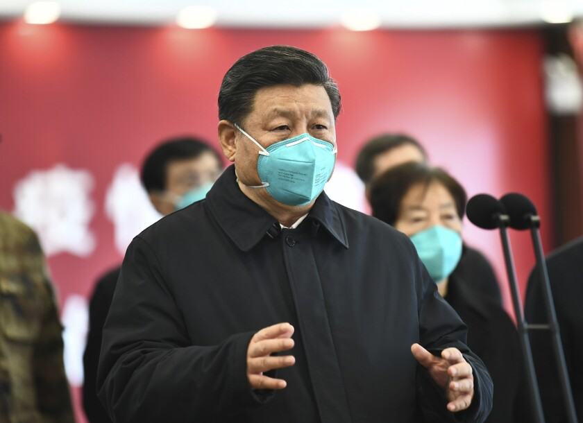 Chinese President Xi Jinping talks by video with patients and medical workers at a hospital in Wuhan on March 10, 2020.