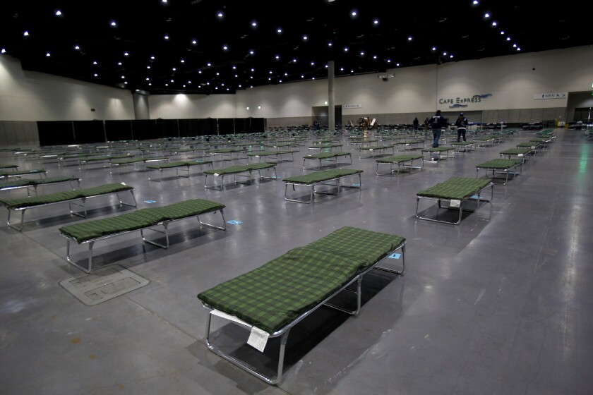Photo of beds setup in San Diego Convention Center for Homeless during COVID.