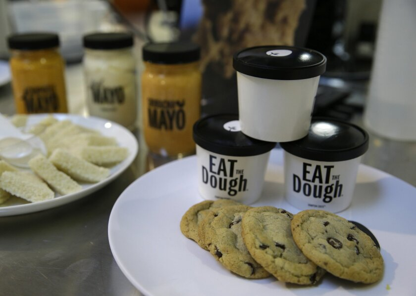 In this photo taken Tuesday, Dec. 3, 2013, plant-based products including chocolate chip cookies, cookie dough and mayonnaise are displayed at Hampton Creek Foods in San Francisco. Can plants replace eggs? A San Francisco startup backed by Bill Gates believes they can. Hampton Creek Foods is scouring the planet for plants that can replace chicken eggs in everything from cookies to omelets to French toast. Funded by prominent Silicon Valley investors, the upstart seeks to disrupt a global egg industry that backers say wastes energy, pollutes the environment, causes disease outbreaks and confines chickens to tiny spaces. (AP Photo/Eric Risberg)