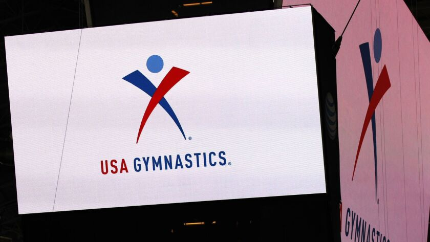 FILE - In this Feb. 26, 2014, file photo, the USA Gymnastics logo is displayed at AT&T Stadium durin