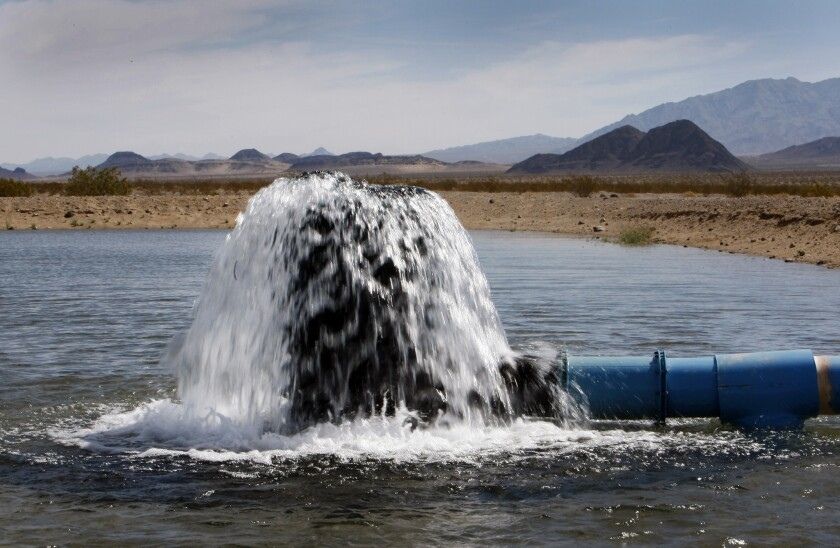 Water pours from a pilot well on Cadiz Inc. property in the Mojave Desert in 2012.