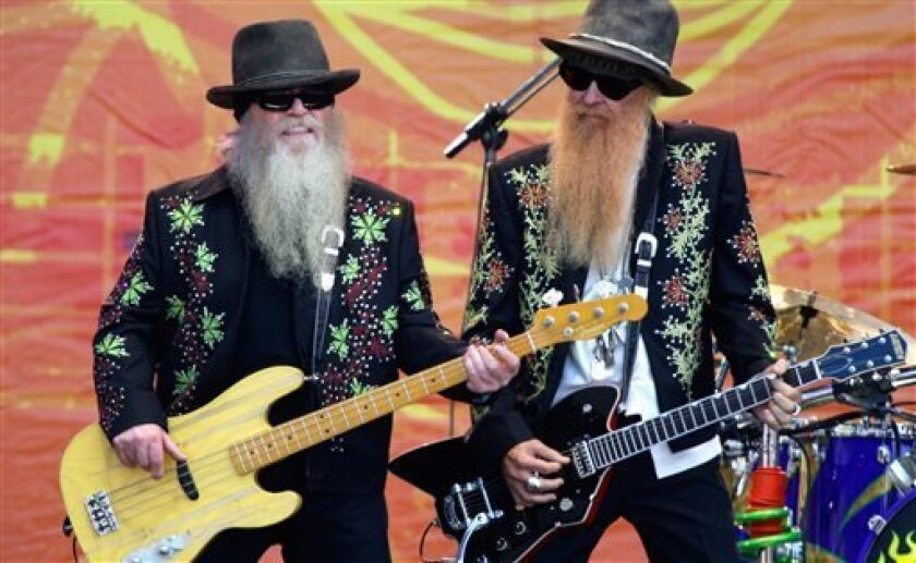 FILE - In this June 26, 2010, file photo, Dusty Hill, left, and Billy Gibbons of ZZ Top perform during the Crossroads Guitar Festival in Chicago. (AP Photo/Kiichiro Sato, File)