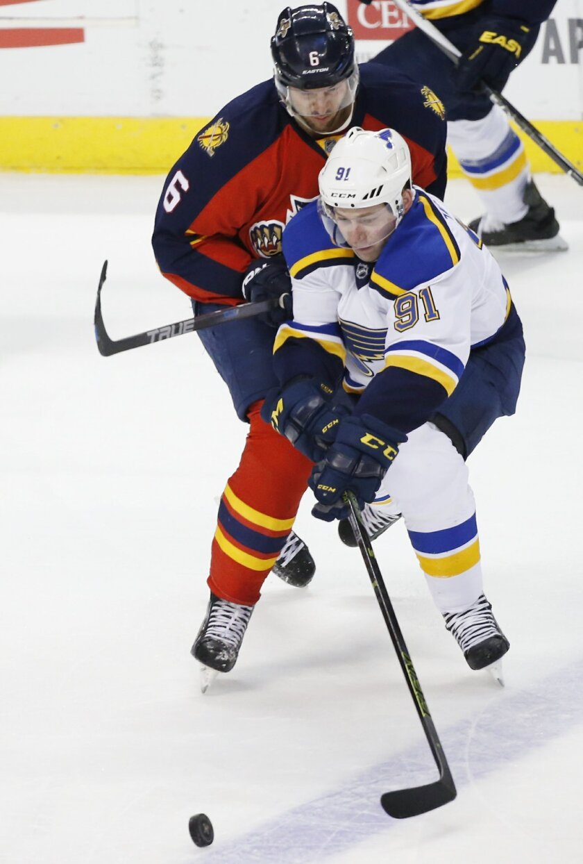 St. Louis Blues right wing Vladimir Tarasenko (91) and Florida Panthers defenseman Alex Petrovic (6) battle for the puck during the second period of an NHL hockey game, Friday, Feb. 12, 2016, in Sunrise, Fla. (AP Photo/Wilfredo Lee)