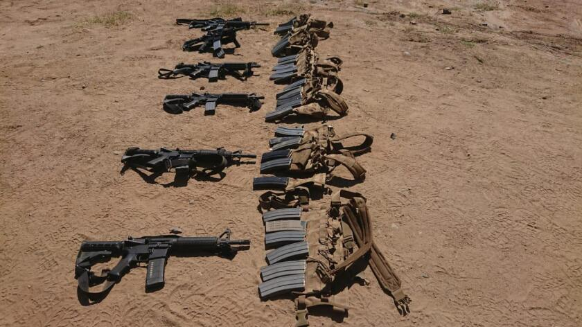 Mexican Army arrests two men in California truck full of AR-15 rifles and heavy-gauge machine guns.