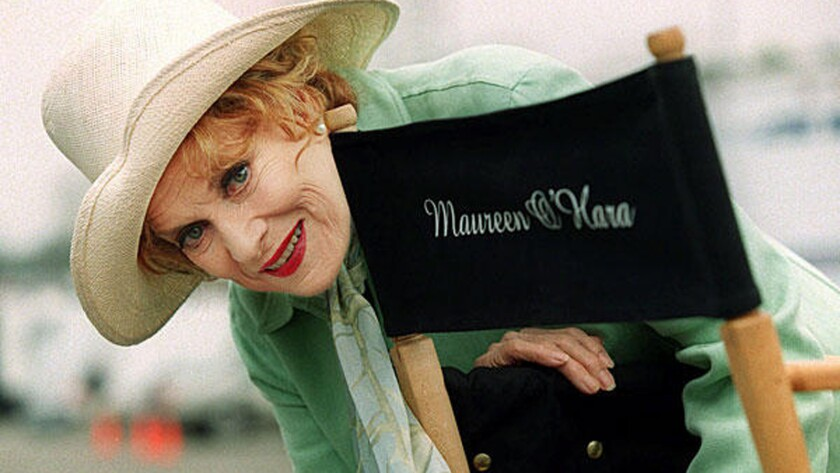 Veteran actress Maureen O'Hara poses by her cast chair on the set of a television movie filming at Santa Monica Pier, May 9, 2000, in Santa Monica, Calif. O'Hara with her flame red hair was the Queen of Technicolor in her heyday, and remained active at age 79.