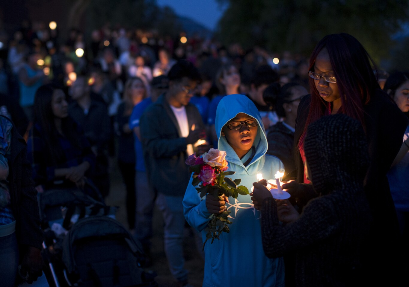 North Park student Elijah Beaven attends a candlelight prayer vigil with his mother, Laura Beaven.