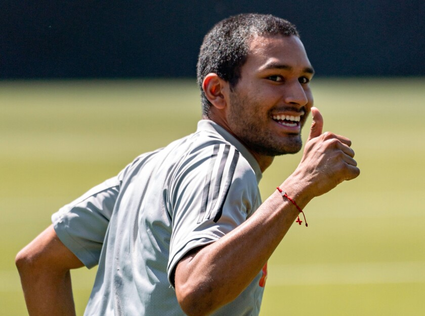 LAFC defender Eddie Segura smiles and gives a thumbs up while taking part in a training session on Thursday.