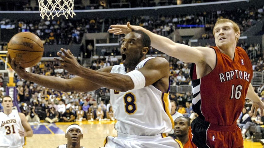 Kobe Bryant gets past Raptors forward Matt Bonner for two of his 81 points.
