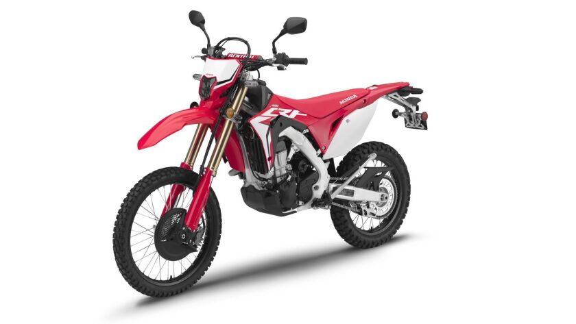 Honda's new CRF450L motorcycle straddles the road and dirt, but may