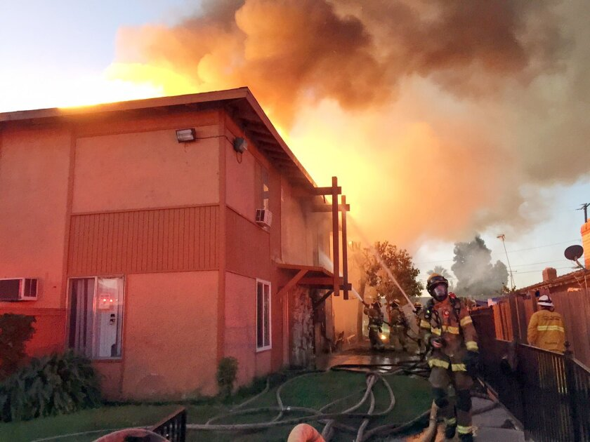 In this photo provided by Anaheim Fire & Rescue, firefighters battle a blaze at two apartment complexes, Friday morning, Nov.  6, 2015, in Anaheim, Calif. Two Anaheim apartment buildings will probably be a total loss after fire raced through them and displaced over 40 people. (Sgt. Daron Wyatt/Anah