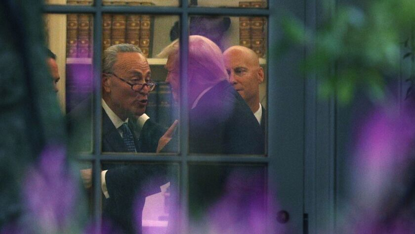 Sen. Charles Schumer, left, with President Trump in the Oval Office.