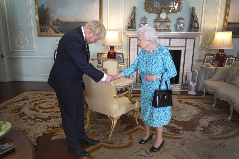 Prime Minister Boris Johnson meets with Queen Elizabeth II in July.