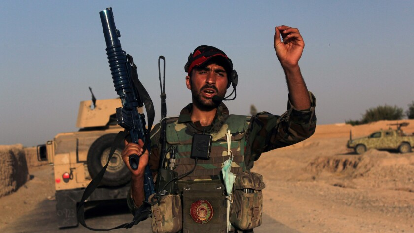 An Afghan soldier patrols in Helmand province on Aug. 12, 2016, following clashes with the Taliban.