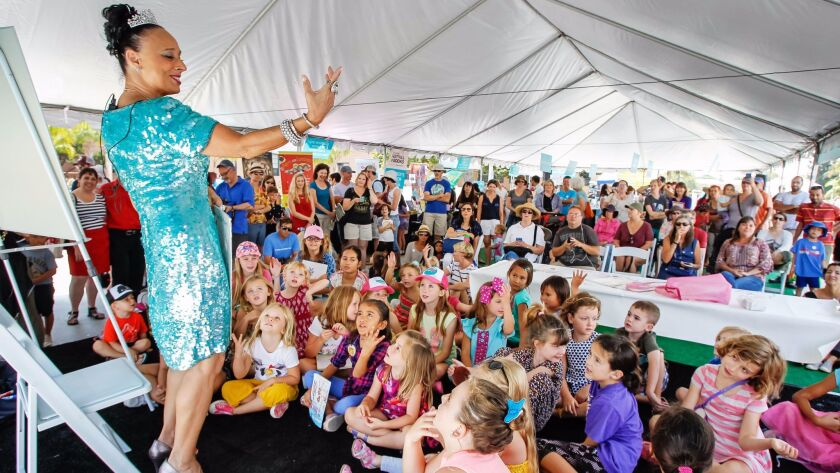 Fancy Nancy book illustrator Robin Preiss Glasser entertains a crowd at the Children's Pavilion on Saturday during the San Diego Festival of Books at Liberty Station