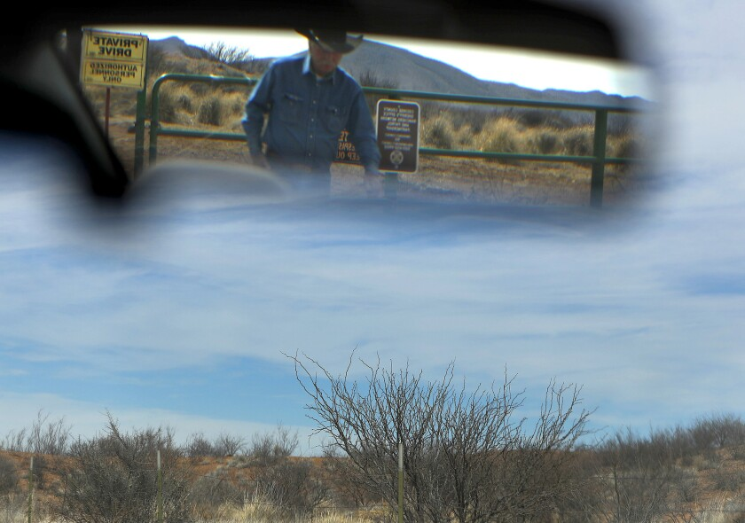 COCHISE COUNTY, ARIZ. -- SATURDAY, MARCH 2, 2019: John Ladd is reflected in a mirror as he checks on
