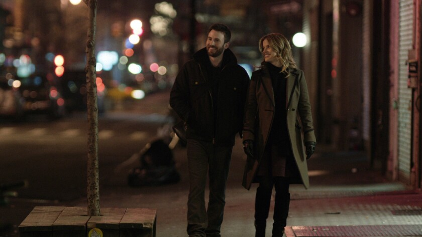"""Chris Evans, left, as Nick Vaughan, and Alice Eve, as Brooke Dalton, in a scene from """"Before We Go."""""""