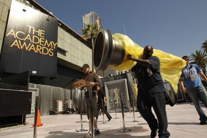 ABC will live stream the Academy Awards this year on a limited basis. Oscar statues are moved into place as preparations are made for the 2012 ceremony.
